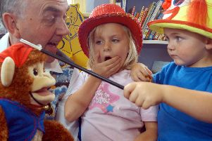 2007: Aimee Johnson and Ben Johnson are wowed by Barry Kays magic at Hucknall Library. Can you do a magic trick?