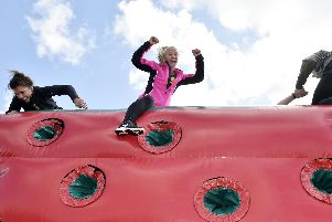 Amanda Lupton of Kippax reaches the top of one of the inflatables