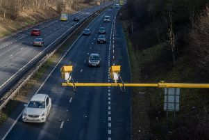 This police car dash cam footage shows a foolish driver slam on his brakes and stop in a motorway fast lane - blocking the way of an officer rushing to an emergency.