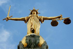 'Despicable human being' who bit off part of ex-girlfriend's ear jailed