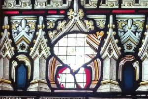 Part of a stained glass window was smashed through by vandals.