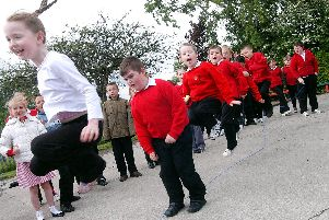 2009: Pupils from Springfield Primary School in Bulwell jump for joy after the school gained a good OFSTED report and are pictured demonstrating a skipping craze that swept through the school. Did you try this?