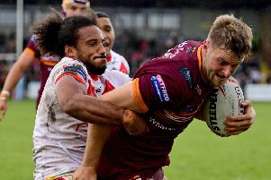 Paul Brierley holds off Joel Farrell on his way to scoring the Bulldogs opening try. Pics: Paul Butterfield