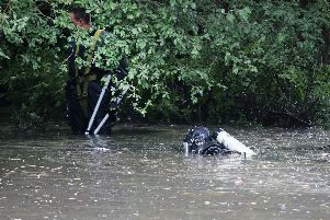 Police divers are searching a pond on Newland Gardens, Newbold, for the body parts of Chesterfield man Graham Snell, who was allegedly murdered.