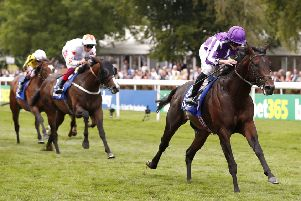 Ten Sovereigns ridden by jockey Ryan Moore.