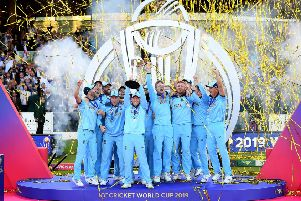 LONDON, ENGLAND - JULY 14:  Eoin Morgan of England celebrates with his team as he lifts the Cricket World Cup trophy after the Final of the ICC Cricket World Cup 2019 between New Zealand and England at Lord's Cricket Ground on July 14, 2019 in London, England. (Photo by Clive Mason/Getty Images)