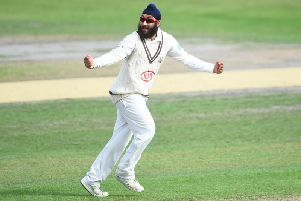 Amar Virdi spun Surrey to victory at Trent Bridge.