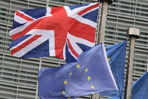 This photo taken on December 8, 2017 at the European Commission in Brussels shows the British national flag raised on a flagpole next to flags of the European Union. 'Britain and the EU reached a historic deal on December 8 on the terms of the Brexit divorce after the British Prime Minister rushed to Brussels for early morning talks.  / AFP PHOTO / EMMANUEL DUNAND        (Photo credit should read EMMANUEL DUNAND/AFP/Getty Images)