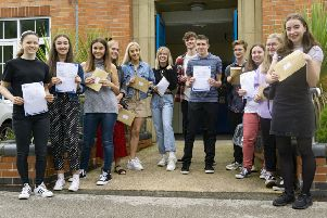 Sixth form students at The Kimberley School celebrate their A-level results.