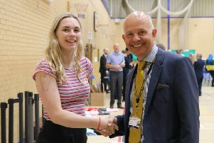 Peter Roberts, Headteacher of Heckmondwike Grammar School, congratulates a pupil on her A-Level results