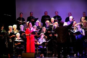 The Clitheroe Grand Choir and Vicky Little performing.