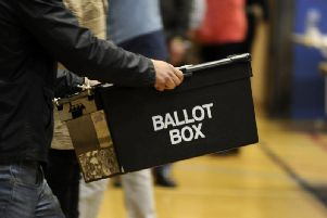 Ballot boxes are carried into the hall at the Richard Dunn Centre, Bradford, for counting in the 2015 General Election. Pic: Bruce Rollinson
