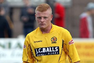 Kieran Wells in action for Belper Town.
