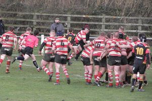 Mikey Hayward (top centre) capitalises from a break to score in the corner during Cleckheaton's derby victory at Bradford & Bingley in North One East last Saturday. Picture: Gerald Christian.