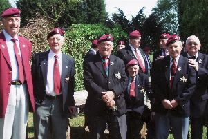War veteran Pete Watkins (sitting) pictured at a Derbyshire paras reunion in 2011.