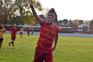 Alex Marshall celebrates scoring for Ilkeston Town.