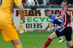 Ben Morris takes a pop at goal for Matlock against Sheffield United in a pre-season friendly