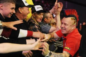 Peter Wright is welcomed to Leeds Arena last year.