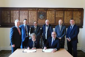 Erewash Borough Council leader Carol Hart signing the outsourcing contract for services at five local leisure centres with Glen Hall, operations director at Parkwood Leisure Ltd.