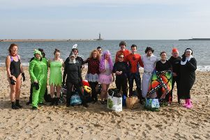 Michael Ward (fourth from right) and friends from Fausto Bathing Club took part in a fancy dress swim at Roker beach, Sunderland, to raise funds for a refugee charity in Algeria.