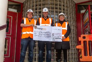 Playhouse technical manager Andy Hunt, left, and theatre manager Jo Potts, with Adam Lambert, centre, chairman of Alnwick Round Table handing over a cheque for �2,000. Picture by Andrew Mounsey.