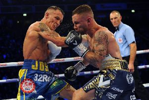 Josh Warrington lands a right hand on Carl Frampton during their dramatic clash in Manchester before Christmas.