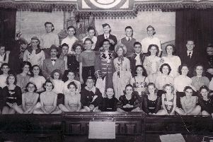 The cast of a pantomime being performed at Ilkeston Town Hall. The year is unknown.