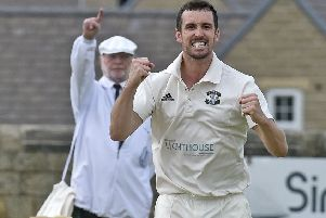 Got him: Otley's 'James  Davies celebrates trapping Collingham's Toby Jacklin for a duck on his way to taking the first three wickets in a 141-run win forthe Aire-Wharfe leaders.
