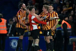 Bradford City's Stephen Darby (second right) celebrates with team-mate Billy Knott (second left) and Rory McArdle (left) at Stamford Bridge in January 2015. Picture: John Walton/PA