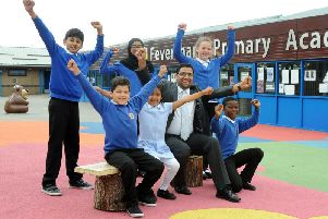 Feversham Primary Academy school council celebrate headteacher, Naveed Idrees, winning the Headteacher of the Year category in the 2019 TES School Awards