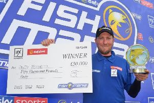 Andy Bennett, with his �50,000 prize for winning Fish'O'Mania 2019.