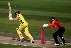 Heading for the games: Women's T20 action as Australia's Ellyse Perry hits out against England at Hove.
