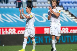 Pablo Hernandez and two-goal Patrick Bamford applaud the 5,000 travelling Leeds United fans at Wigan Athletic.