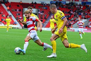 Doncaster's Alfie May: Backed by his manager.