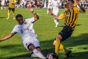 Worksop and Belper battle for possession. Pic by Lewis Pickersgill.