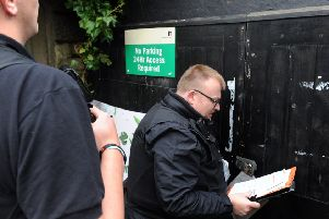 A knock on the door from bailiffs, or enforcement agents, chasing up debts owed to the council.
