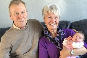 Linda and Allen Nutt with their great granddaughter Aria.