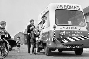 Always a popular visitor, the ice cream man with customers in Wigan in 1967.