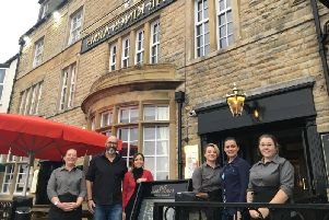 Adam Hulme with staff at The Kings Arms in Morecambe