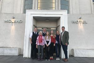 Sarah Oliver and family with Midland Hotel duty manager Kevin Hardy.