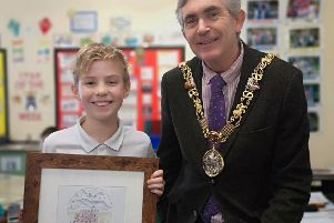 Will Lakin, 10, with Mayor of Lancaster Andrew Kay and the winning card design.