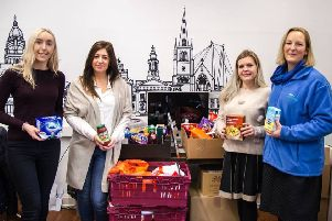 It's Ellys Bagnall, Fiona Lambert, Becky Sewell and Joanna Young, from Hotfoot Design, with their donation for Morecambe Bay Foodbank.