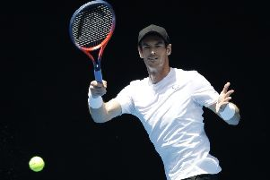 Andy Murray warms up during the weekend for his first-round match in Melbourne (Picture: Kin Cheung/AP).