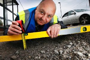 """Mr Pothole"", Mark Morrell, visits Kennington to inspect the potholes. (Picture: ITN)"
