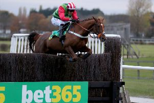 Danny Cook and Definitly Red clear the last in Wetherby's Charlie Hall Chase last November.