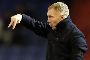 Paul Scholes will be in the opposition dugout tonight when Morecambe travel to Oldham