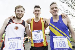 Spen AC's Joe Sagar (centre) celebrates winning the Liversedge half marathon with runner-up Gareth Cooke and third placed Jason Cherriman. Picture: Allan McKenzie