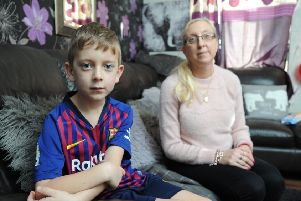 Seven-year-old Zac Harrison fractured his skull after a metal goal post fell on him.  He is pictured with mum Karen Harrison.