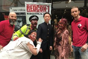 From left: HMV store manager Matt Beddows, Chee Keong Cheung, HMV's assistant manager Liam Carroll with the zombies