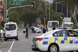 Police block the road near the shooting at a mosque in Linwood, Christchurch, New Zealand, Friday, March 15, 2019. Multiple people were killed during shootings at two mosques full of people attending Friday prayers. (AP Photo/Mark Baker)